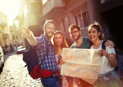 Happy tourists exploring city